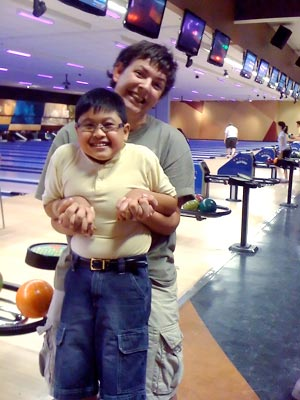 A parent and child at bowling night